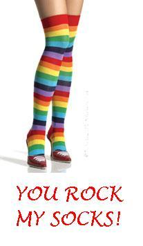 rainbow knee-length socks on some unknown person's legs