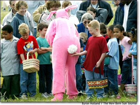 boy grabs easter bunny's tail