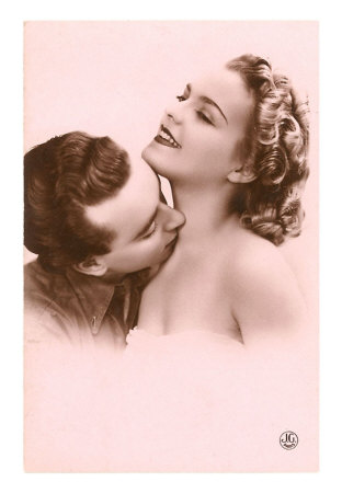 man kissing woman on neck